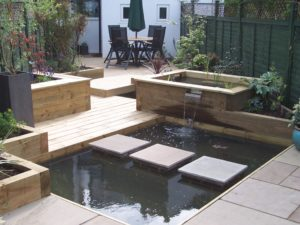 Fully Landscaped Rear Garden with Prominent Water Feature